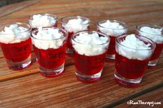Firecracker Rum Shots (Makes about 12 – 1.5 oz. servings) (1 – 3oz. package Strawberry Jello Mix 1 cup boiling water 1 cup banana (or coconut) flavored rum Whipped Cream)