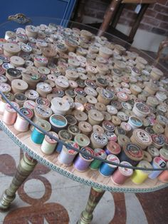 Wooden Thread Spool table..love this! How easy this would be to do....and it would hide a table top with damage. Great in a sewing room.