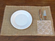 12 x 18 burlap placemats with a napkin/silverware holder covered in lace. but one on each side for full dinner setting. (edges of the napkin/silverware holder and placemat have been neatly frayed and sewn to prevent further fraying)