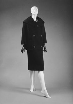 """""""Claro"""" House of Dior (French, founded 1947) Designer: Christian Dior (French, Granville 1905–1957 Montecatini) Date: fall/winter 1957–58 Culture: French Medium: wool Dimensions: Length (a): 27 1/2 in. (69.9 cm) Length (b): 45 1/2 in. (115.6 cm) Length at CB (c): 28 in. (71.1 cm) Credit Line: Gift of Mr. and Mrs. Henry Rogers Benjamin, 1965"""