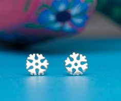 Extra Tiny sterling silver snowflake studs, snowflake earrings with sterling silver posts and ear nuts. The tiny snowflake measures 5mm. This listing