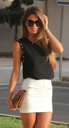 Black studded top with a white skirt!  Simple and cute  Bliss XO online retailer launching Summer 2013
