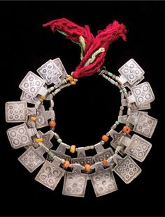 Moroccan Necklace (Ida Ou Nadif style) silver with niello decoration, amazonite, amber, glass, wool, silk. Late 20th century. ©Desert Jewels Catalogue