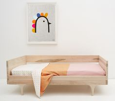 Castle's yellow heart cot bedding and pink and orange Blanky, via WeeBirdy.com.