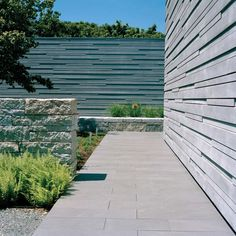 love low wall with greenery to seperate entry from pool and also this siding detail for fence??