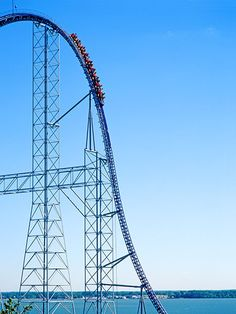 Millenium Force Cedar Point Sandusky OH 310 feet tall 80 degree first drop 93 mph top speed This coaster broke world records as the worlds first gigacoaster when it open. Parc A Theme, Attraction, Amusement Park Rides, Cedar Point, One Drop, Water Slides, World Records, Places To Travel, Road Trip