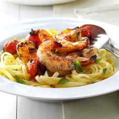 Grilled Shrimp & Tomatoes with Linguine Recipe -This fancied-up pasta came about one night when I was coming up with dinner on the fly. We knew it turned out great with the very first bite. —Lisa Bynum, Brandon, Mississippi