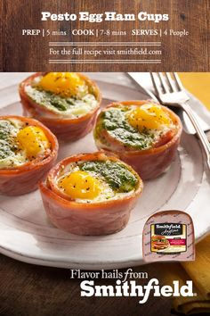 4 slices of precooked Smithfield® Hickory Smoked Premium Quarter Boneless Spiral Ham, cut lengthwise to fit in the muffin tin. , About 2 tsp. of pesto per egg, 4 large eggs, Healthy Muffin Recipes, Low Carb Recipes, Breakfast Recipes, Vegetarian Recipes, Cooking Recipes, Free Recipes, Breakfast Cups, Pesto Eggs, Spiral Ham