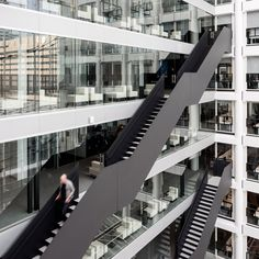 OMA has completed restructured agovernmental office building from the 1990s, creating all-new types of workspaces for the Dutch ministries that occupy it