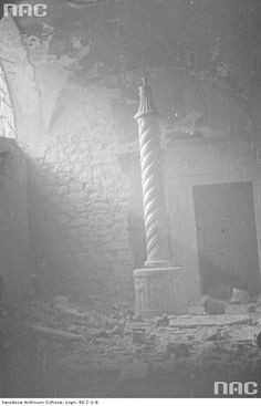 A streak of light shines on a lone decorative column in the ruins of the Monte Cassino Abbey. May, 1944.