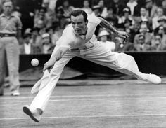 Fred Perry competing in the Gentlemen's Singles at Wimbledon in 1936. He would go on to win the tournament, the last Briton to do so until Andy Murray broke the 77 year title drought in 2013.