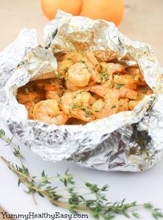 Here's a simple and easy dinner for any night of the week! This Orange-Thyme Grilled Shrimp recipe is cooked in foil packets right on the grill or in the oven, sealing in the moisture and intensifying the fresh flavors!
