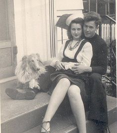 1940s couple. I love this photo so much!! And how they have a dog too! Also how she's wearing his hat!