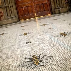 MANCHESTER TOWN HALL BEES: Originally laid out by Venetian craftsmen, the 4,500 yards of beautiful marble flooring in the building primarily feature cotton flowers along its length. But here, 67 bees are laid out in an overhead design. Bee-utiful... Don't you think?  #bees #manchester #beautiful #design