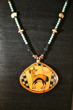 Antelope Totem gourd shard necklace, by gourd artist Carla Bratt.   Series 1 - 2007