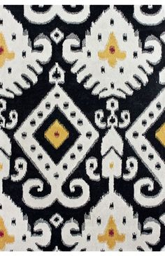 Antique Ikat - not sure why but I am drawn to this rug.  It doesnt match anything we own but I think it's neat