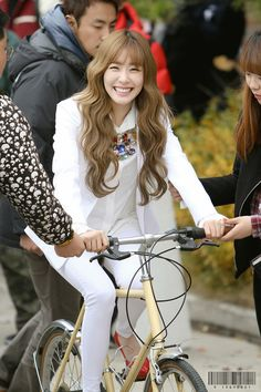 So poor of her because she doesn't know to ride a bicycle