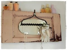 DIY necklace display: old rake head, mirror, & shutter... one of my next projects!