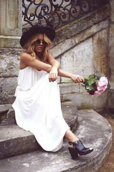 white maxi dress, black hat, flowers, sunnies