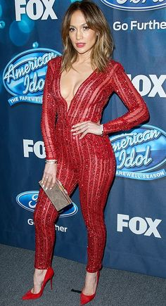 Jennifer Lopez in a red Zuhair Murad sparkly, plunging jumpsuit and matching pumps