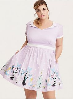 """This bright lavender cotton swing dress is a total #tbt with a foldover collar, piping and a swing skirt that's boosted by a tulle underlay. The skirt's border gets curiouser and curiouser with a Mad Hatter tea party inspired print. The foldover back has been embroidered with a swirling """"we're all mad here.""""<div><br></div><div><b>Model is 5'10"""", size 1<br></b><div><ul><li style=""""list-style-position: inside !important; list-style-type: disc !important"""">Size 1 measures 38 1/2"""" from..."""
