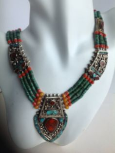 Ethnic Tibetan Coral & Turquoise Necklace An absolutely exceptional, hand-made Tibetan silver Pendant necklace, delicately inlaid with turquoise and coral stones. Necklace is strung with old Tibetan green turquoise stones, coral and silver spacer beads. One-of-a-kind and elegant. Beaded Jewelry, Jewelry Box, Beaded Necklace, Jewelry Making, Coral Stone, Turquoise Stone, Silver Pendant Necklace, Turquoise Necklace, Coral Turquoise