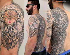 Beautiful geometric tattoo with hindu god tucked away on arm