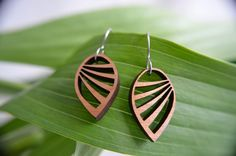 Wing earrings in laser-cut walnut on surgical steel ear wires - www.giogiodesign.com