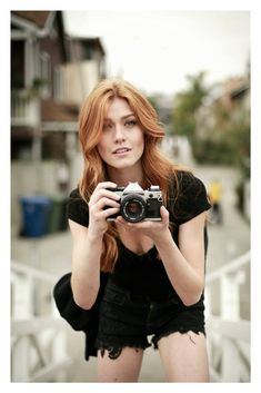"Mari with one of Adrian's old cameras. ""Ever think of being on the other side of the lens, ice boy?"""