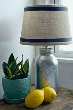 Shine a light on your awesome craft skills by making this DIY Mason Jar Lamp. You can brighten up your living room or bedside table with this mason jar craft idea. Large Mason Jars, Hanging Mason Jars, Mason Jar Lamp, Mason Jar Projects, Mason Jar Crafts, Bottle Crafts, Ana White, Glass