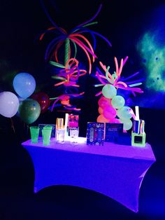 glow party upgrade white gift table with neon black light reactive balloons