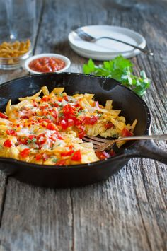 Easy Tex-Mex Migas - Eggs scrambled with tortillas Tex-Mex style with jalapeños, green onions, and white onions for added flavor. A generous helping of cheese makes it extra good. Brunch Recipes, Breakfast Recipes, Dinner Recipes, Migas Recipe, Breakfast Time, Mexican Breakfast, Whole Wheat Pizza, Mexican Food Recipes, Ethnic Recipes
