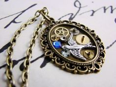 Steampunk Necklace with Vintage Watch Movement Gears Swarovsky Crystals Bird #Pendant #vintage #jewelry