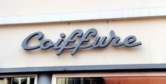 Fleurs Coiffeur Liqueur - 100s of pictures of typography on signs at florists, barbershops & liquor stores around the world.
