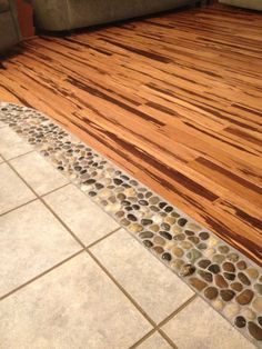 River rock in between wood and tile floors, between the kitchen& Living room and maybe even dining area and den? Description from pinterest.com. I searched for this on bing.com/images