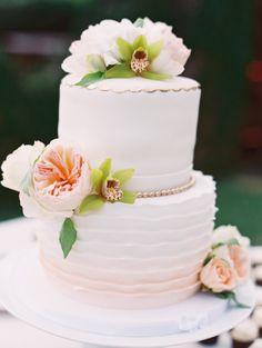 Ombre ruffle cake: http://www.stylemepretty.com/destination-weddings/2015/04/14/elegant-hawaii-summer-wedding/   Photography: Ashley Goodwin - http://www.ashleygoodwinphotography.com/