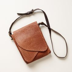 """RIVER'S BEND CROSSBODY BAG--An undeniably American look with hand-stitched details, pebbled leather and asymmetrical, crossover construction. Leather lined. USA. Exclusive. Approx. 8""""W x 2-1/2""""D x 11""""H."""