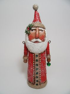 This serious Santa stands 7 1/2 inches high and is made from a paper mache/ sawdust mixture. He has been painted, stained, sealed and dusted with snowy glitter.  He wears tiny bead buttons and a sprig of pine and holly in his hat. His arms are jointed with rusty wire and he carries a little jingle bell.  ...a unique addition to your Santa collection.  I do ship world wide. Please message me for rate.  Thanks for looking :)
