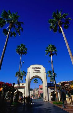 """Gates to Fantasy: entrance to Universal Studios, Hollywood, Los Angeles."" Photography art prints and posters by Lonely Planet Images - ARTFLAKES.COM"