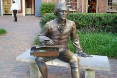 Statue of Thomas Jefferson with his writing box in Williamsburg, Virginia.