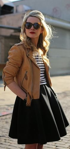 Leather jacket, striped top with pleated black skirt