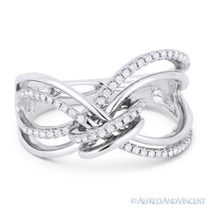 The featured ring is cast in 14k white gold and showcases a fancy design accentuated with round cut diamonds set along looping lines knotted at the center.  #diamonds #fashionrings #14kjewelry #14ktgold #whitegold #rings