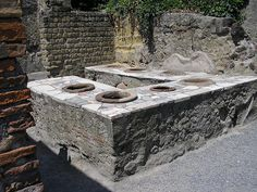 Thermopolium, Herculaneum. The thermopolium was something like a fast food restaurant, where lower class Romans that could not afford a private kitchen could go to get a quick hot meal in the neighborhood.