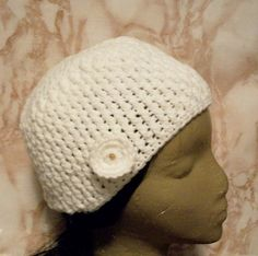 This is a handmade hat in my Stylin Snaps Collection.  See how the collection works on my blog http://handmadebydroxy.com/introducing-my-stylin-snaps-collection/ This hat is machine wash and dry when