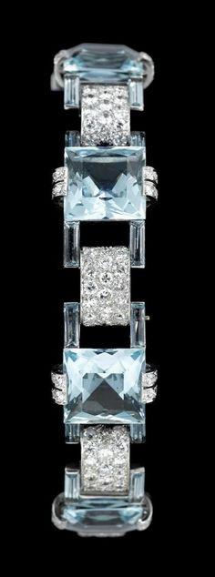 18 karat white gold diamond and aquamarine dinner bracelet mid century Six square cut aquamarines separated by convex pave set diamond links in the Art Deco style. Aquamarine Jewelry, Gemstone Jewelry, Gold Jewelry, Antique Jewelry, Vintage Jewelry, Art Nouveau Jewelry, Schmuck Design, High Jewelry, Color Azul