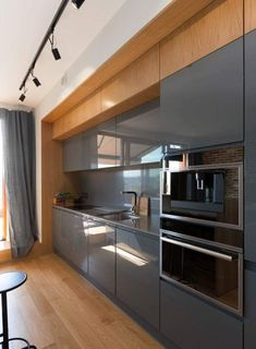 There are hundreds of awesome design ideas for kitchen cabinets and this article will discuss a few of the more popular ones. Many homeowners, whether they are designing a kitchen for a new home or an existing home, will find that selecting a reputable. Kitchen Sets, Living Room Kitchen, New Kitchen, Kitchen Decor, Modern Kitchen Cabinets, Kitchen Cabinet Design, Kitchen Furniture, Best Kitchen Designs, Modern Kitchen Design