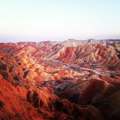 """Zhangye Danxia The Danxia landform refers to various landscapes found in southeast and southwest China that """"consist of a red bed characterized by steep cliffs"""". It is a unique type of petrographic geomorphology found in China."""