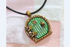 the hobbit jewelry green door locket necklace can by curtainbrand