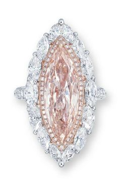 A COLOURED DIAMOND AND DIAMOND RING SET WITH A MARQUISE-CUT LIGHT PINKISH BROWN DIAMOND WEIGHING APPROXIMATELY 5.01 CARATS, WITHIN A BRILLIANT-CUT PINK DIAMOND TRIM AND MARQUISE-CUT DIAMOND SURROUND, TO THE SINGLE-CUT DIAMOND EDGE AND HALF-HOOP, MOUNTED IN 18K WHITE AND ROSE GOLD