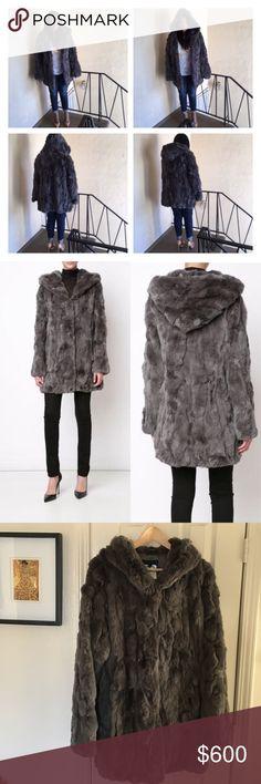 Jocelyn Hooded Rabbit Fur Coat Sz XL Jocelyn Gray Hooded Rabbit Fur Coat. It's never been worn my mom purchased it for me a few months ago. New Without Tags... I will post measurements soon! Jocelyn Jackets & Coats